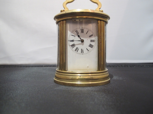 miniature carriage clock by Henri Jacot